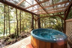 The hot tub overlooks the river