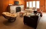The downstairs living area, fireplace, TV